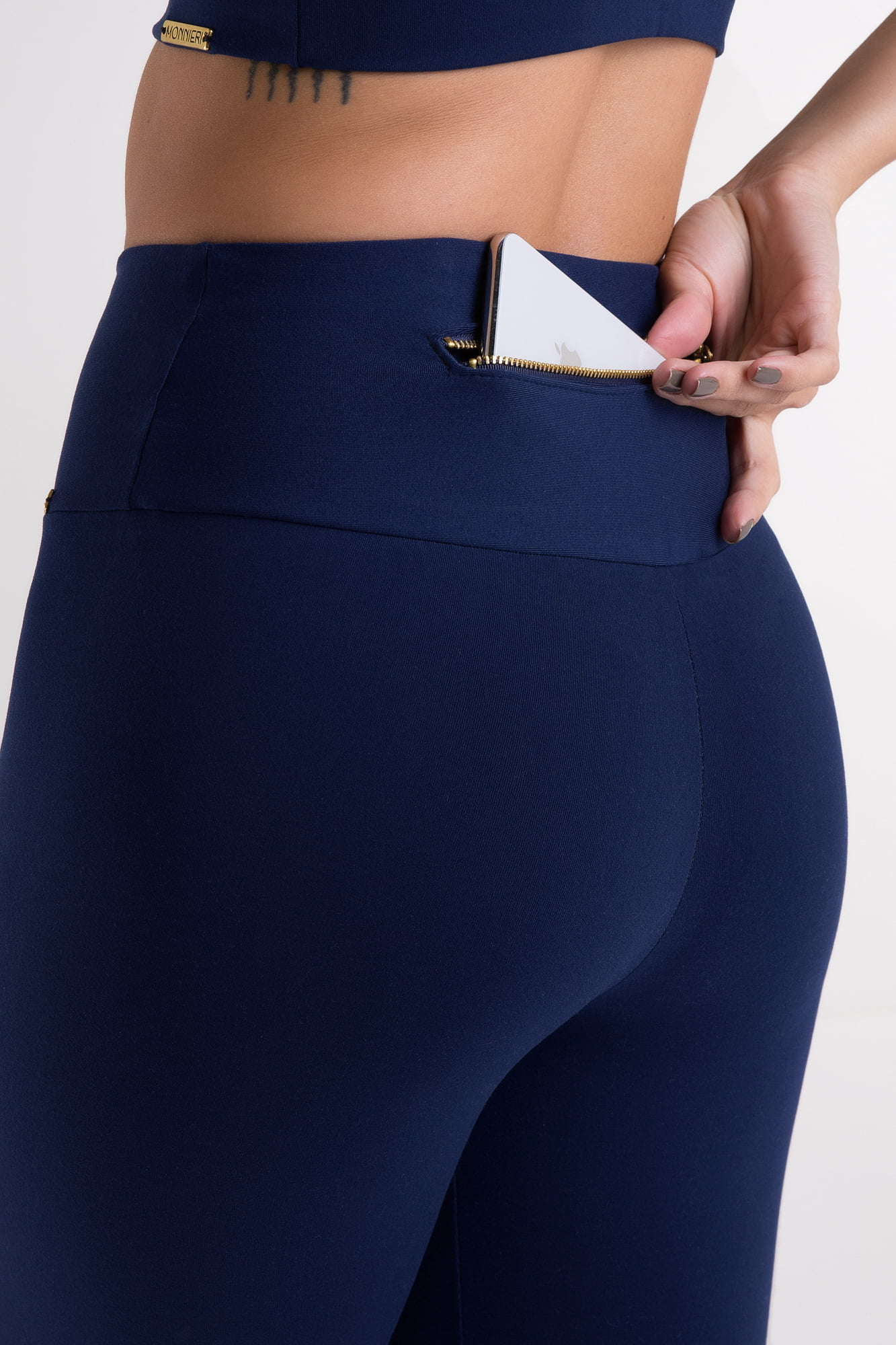 Calça Legging azul marinho com bolso de zíper dourado